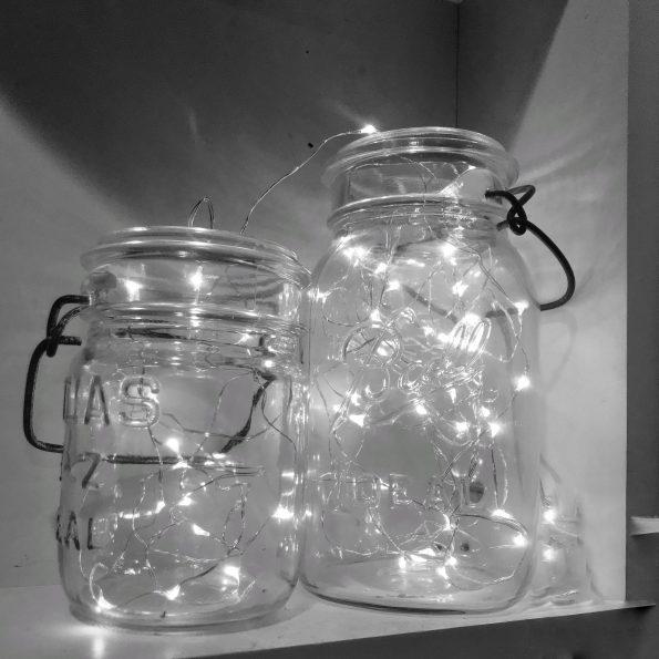 Twinkle holiday lights in vintage canning jars.